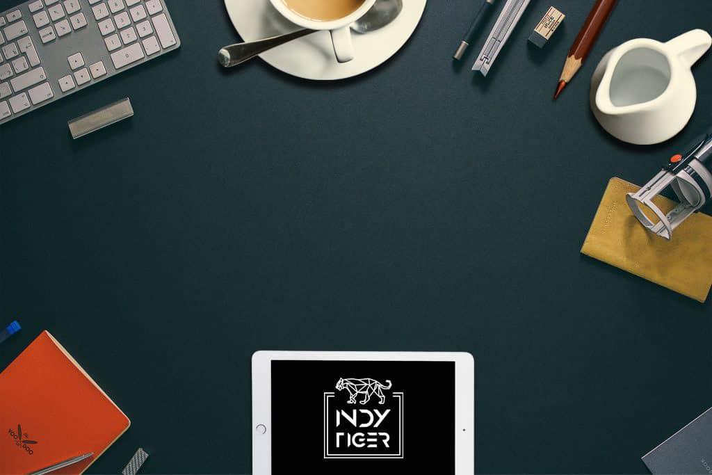 Laptop, Notepad, coffee, milk jug & glasses