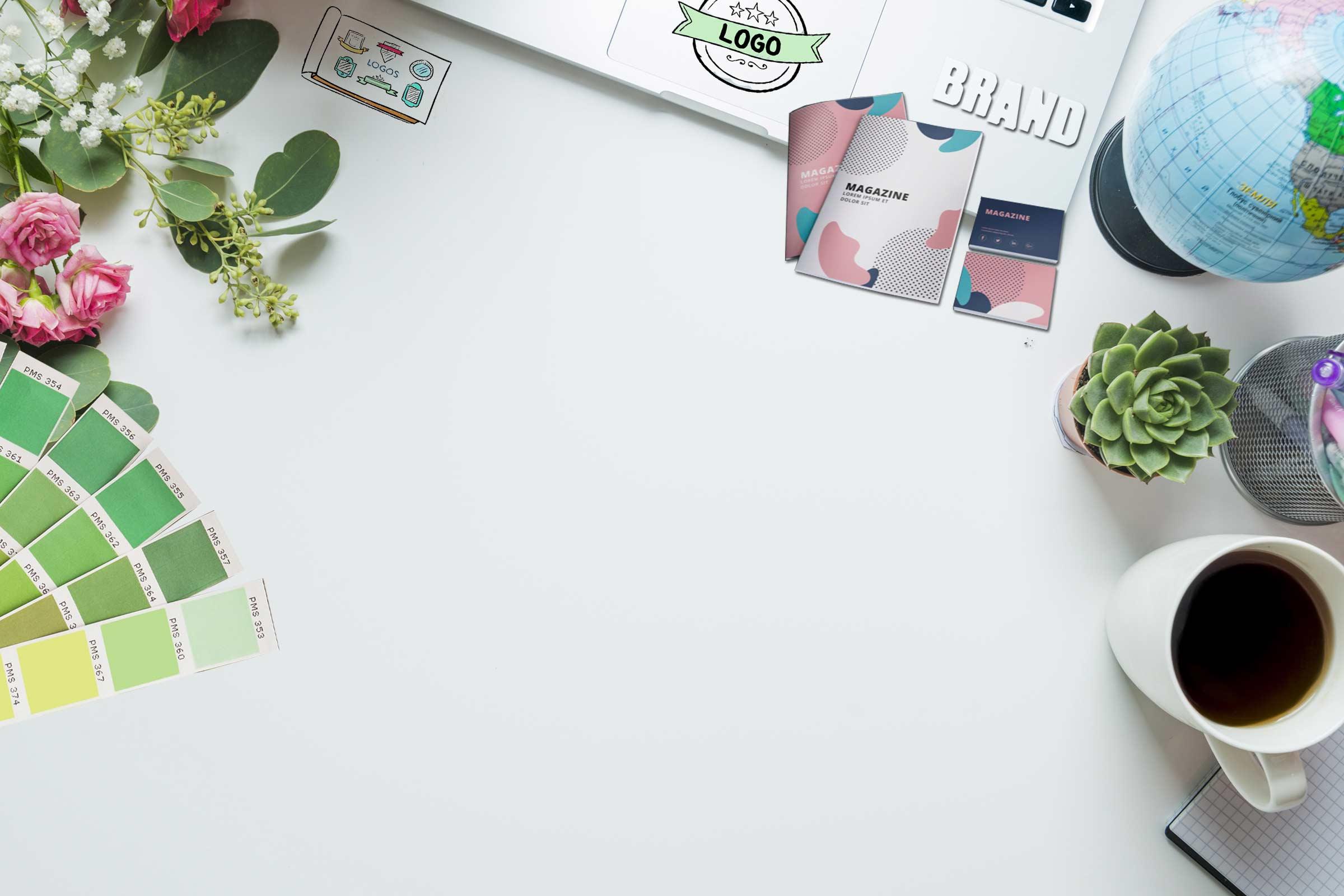 Laptop surranded by print design images